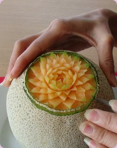 The Begining Of A Melon Carving
